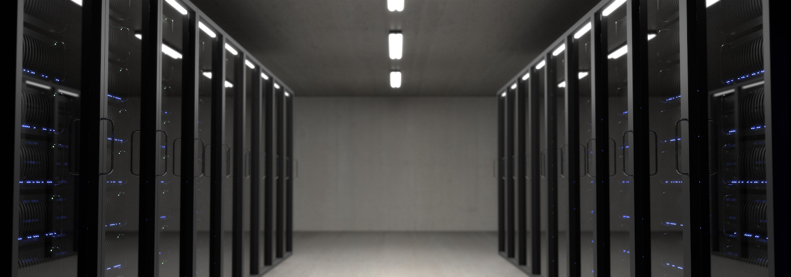 Hallway with two rows of black data processors