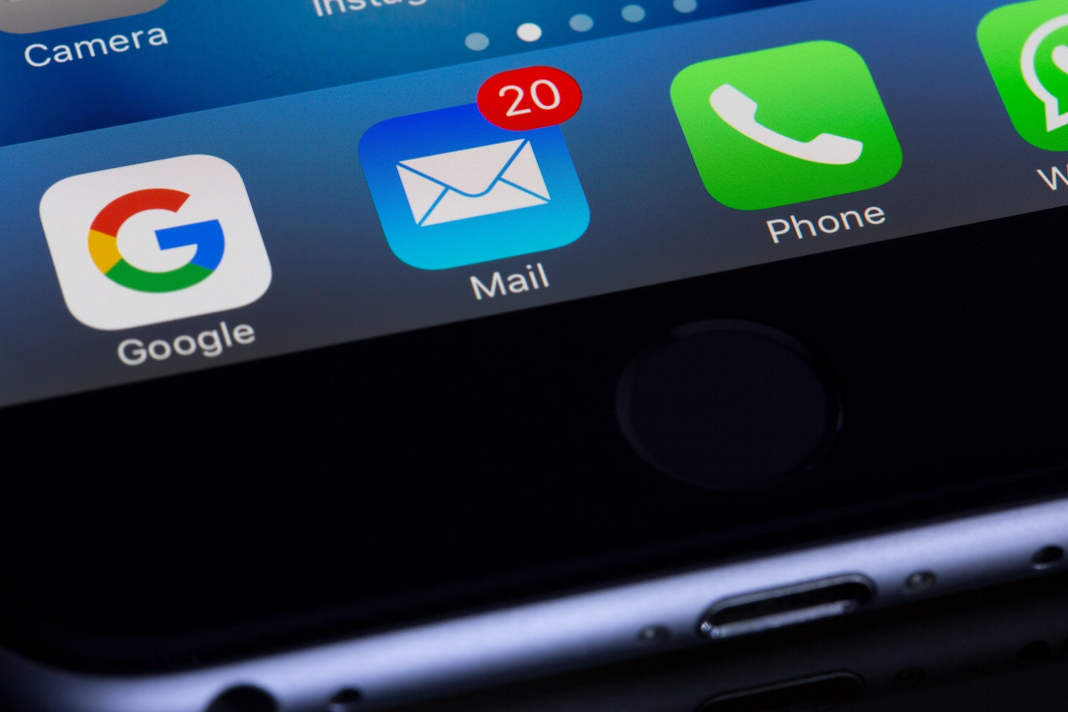 Black iPhone with home screen on, featuring Google, Mail, Phone