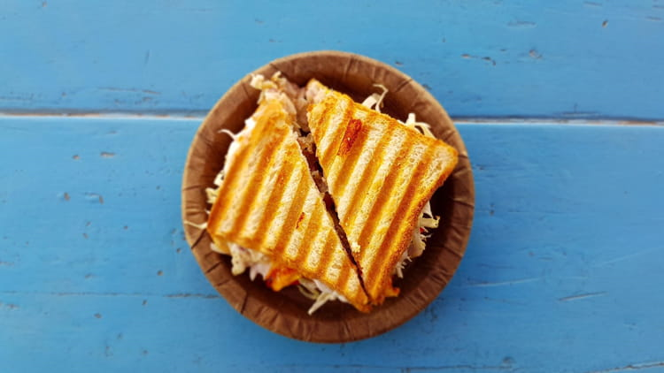 toasted cheese sandwich on wooden plate