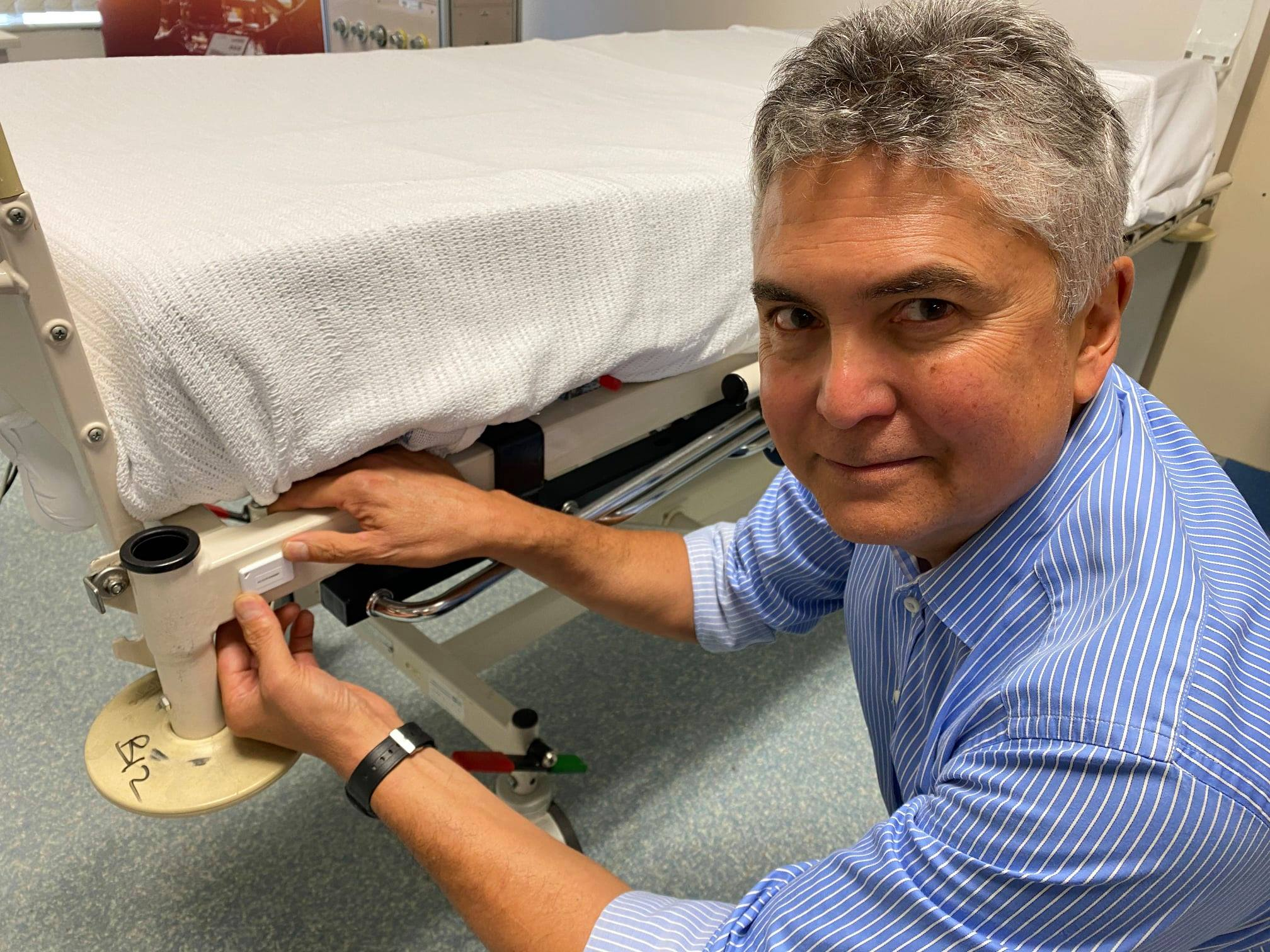 Spotto CEO Alan Williams with a beacon-tagged hospital bed at Gosford Hospital.