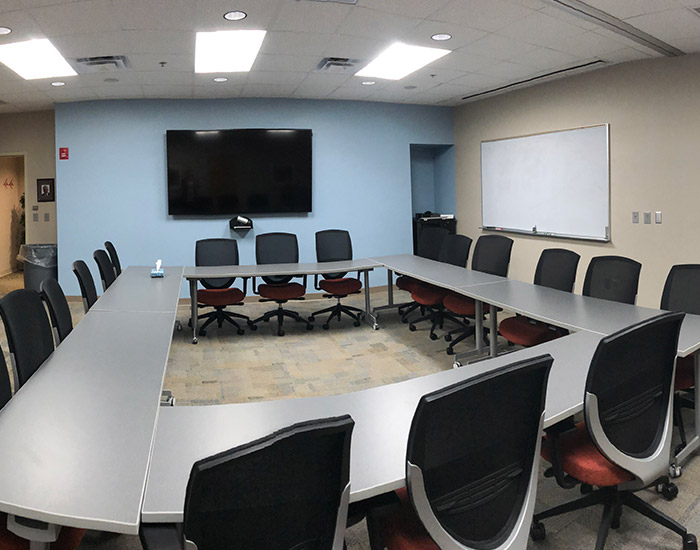 A conference room with a projector
