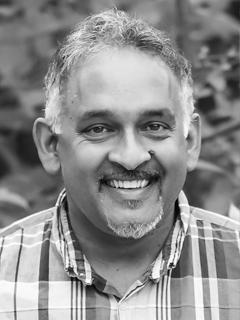 A headshot of Sunil Singh.