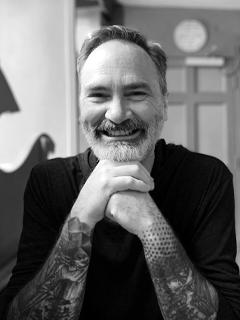 A headshot of Sean Michael Morris.