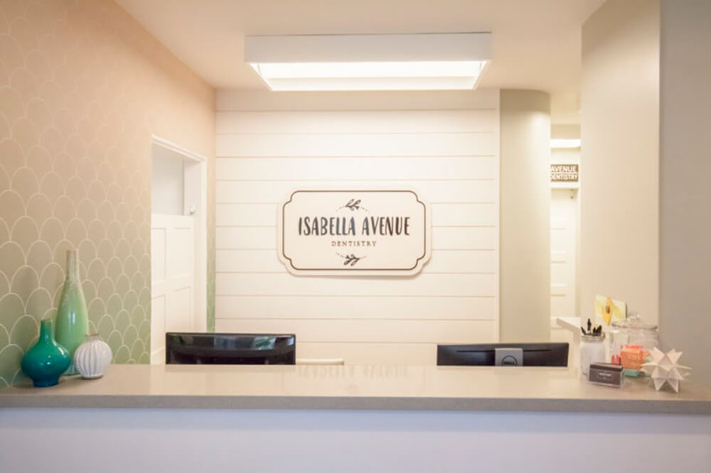 View of our recently renovated front desk and new Isabella Ave Dentistry logo