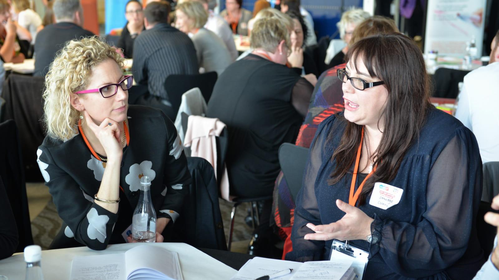 Women engaged in conversation