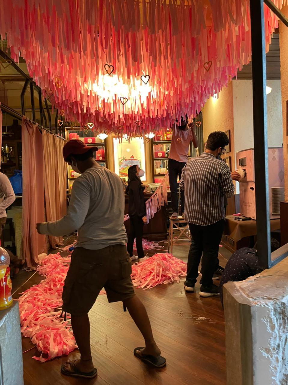 The Studio Rêver team installing a valentine's pop-up at the Bombay Canteen