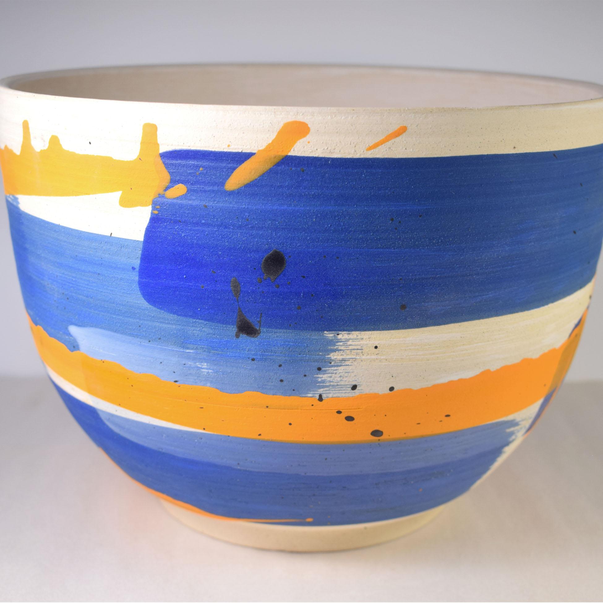 Large ceramic planter with blue, orange and black brush work