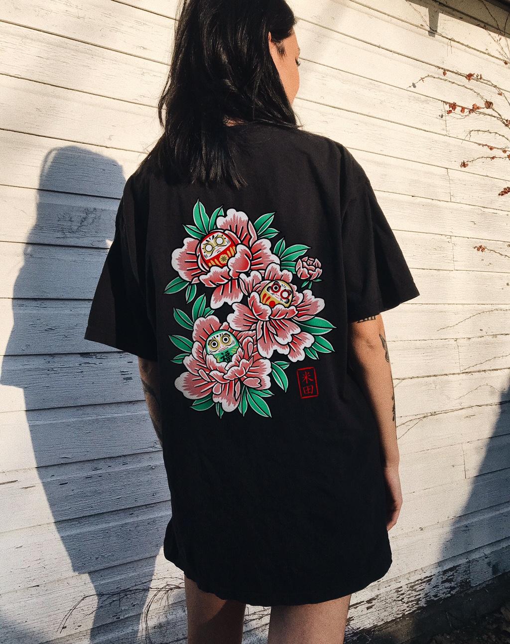 Girl wearing black floral t-shirt