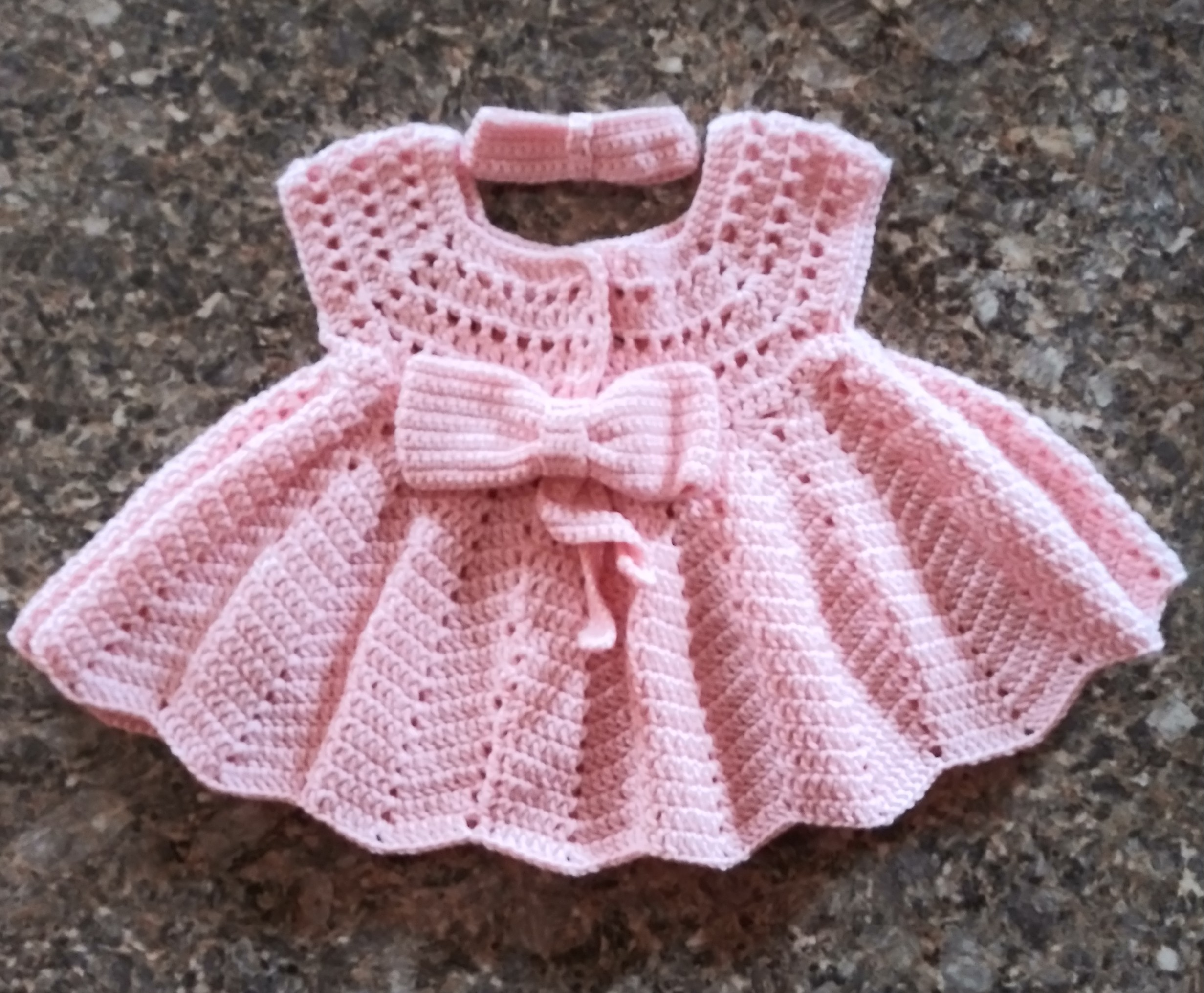 Pink tank-top baby dress with barrette