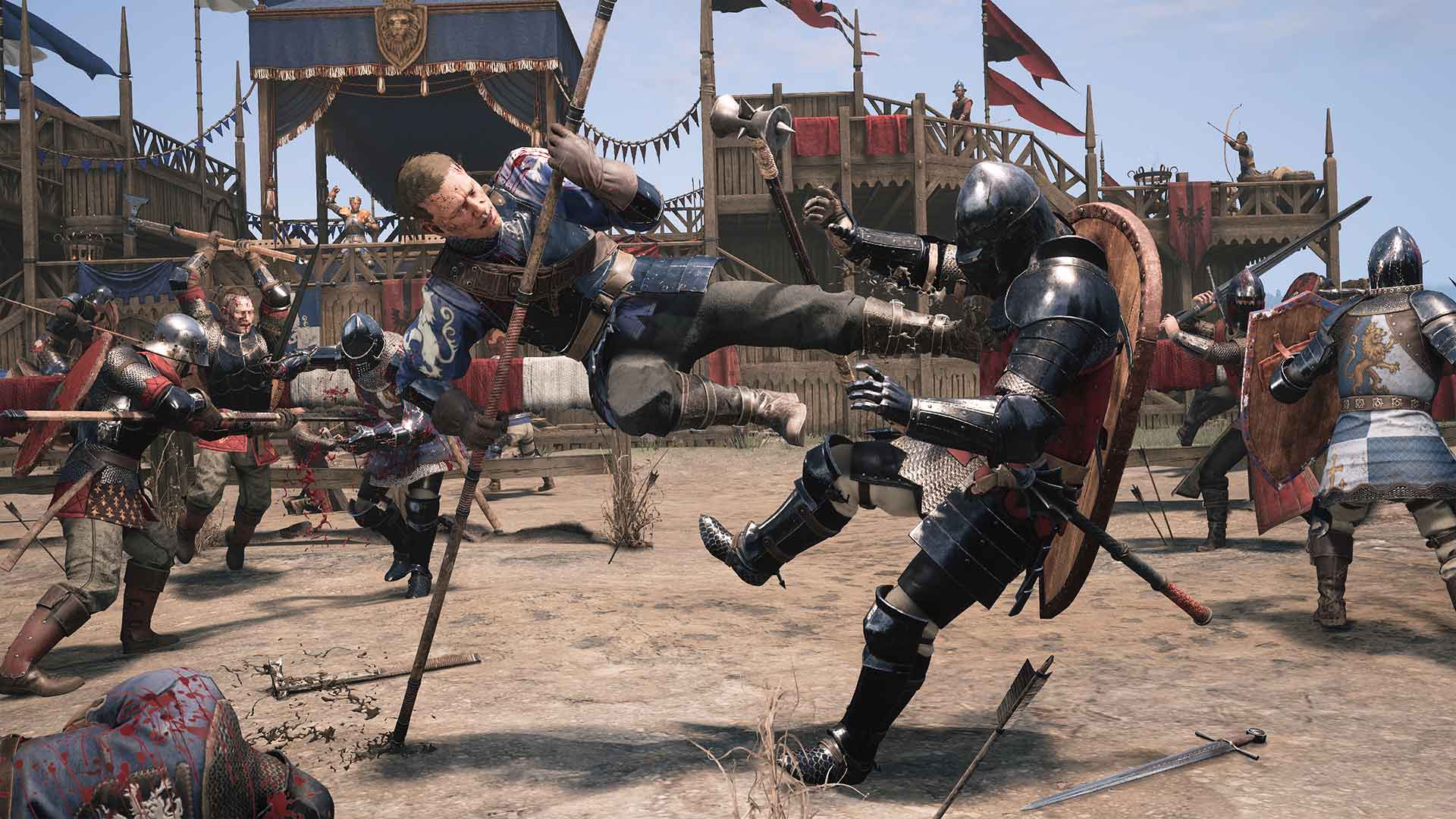 A cinematic shot from Chivalry 2, a blue-armoured warrior kicking a knight in the chest.