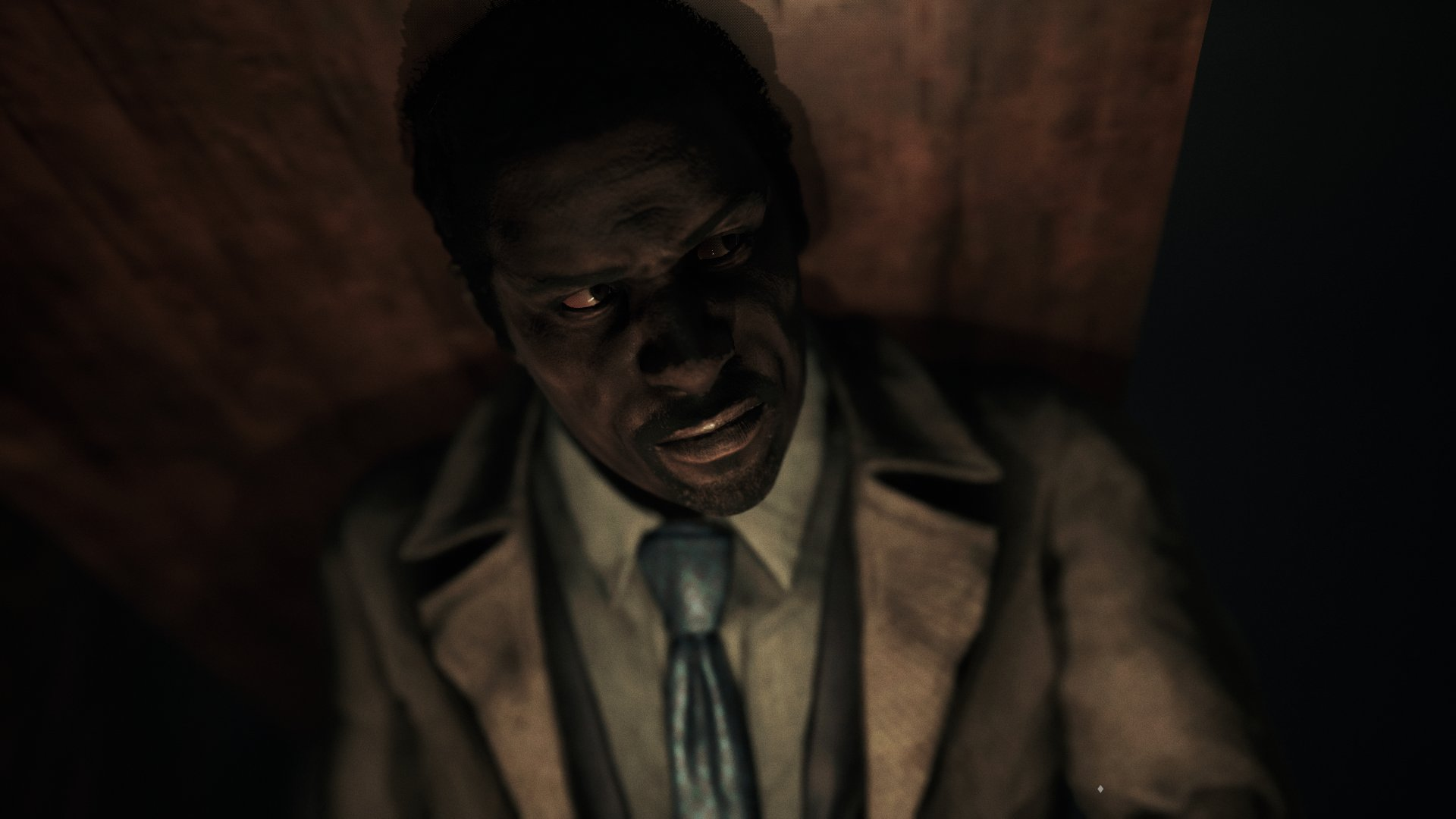A screenshot from Song of Horror, a man stood with his back to a wooden door, listening intently.