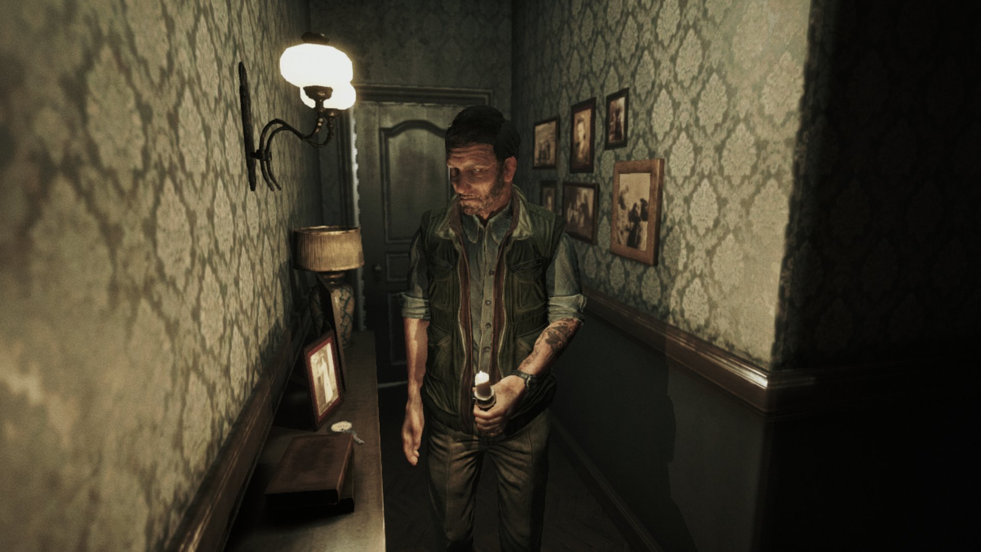A screenshot from Song of Horror, a man exploring a hallway lined with framed photographs.