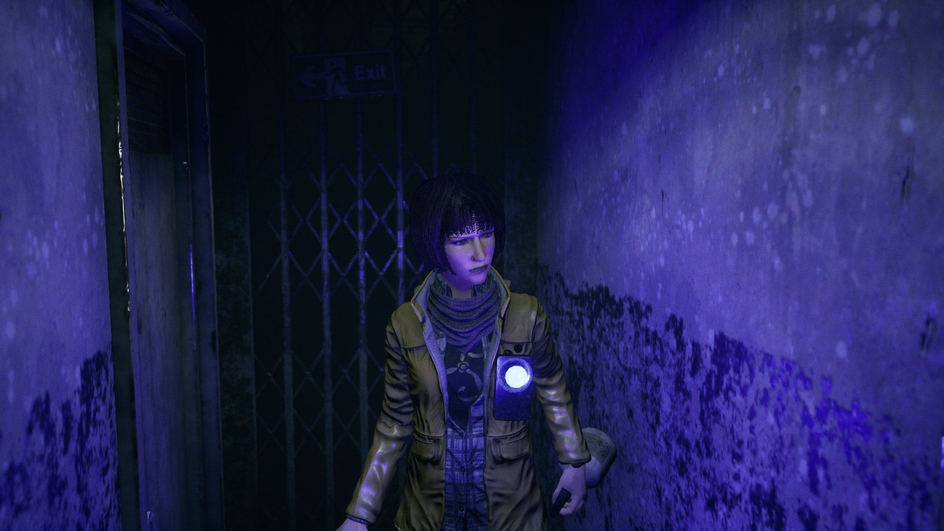 A screenshot from Song of Horror, a woman exploring a blue-lit hallway, with strange patterns on the walls.