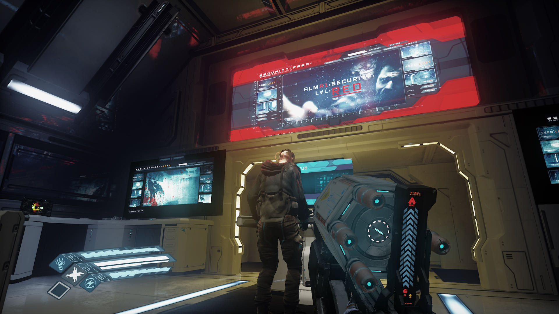 """A screenshot from The Persistence, you're looking up at two large screens showing security level """"red"""", which can't be good."""