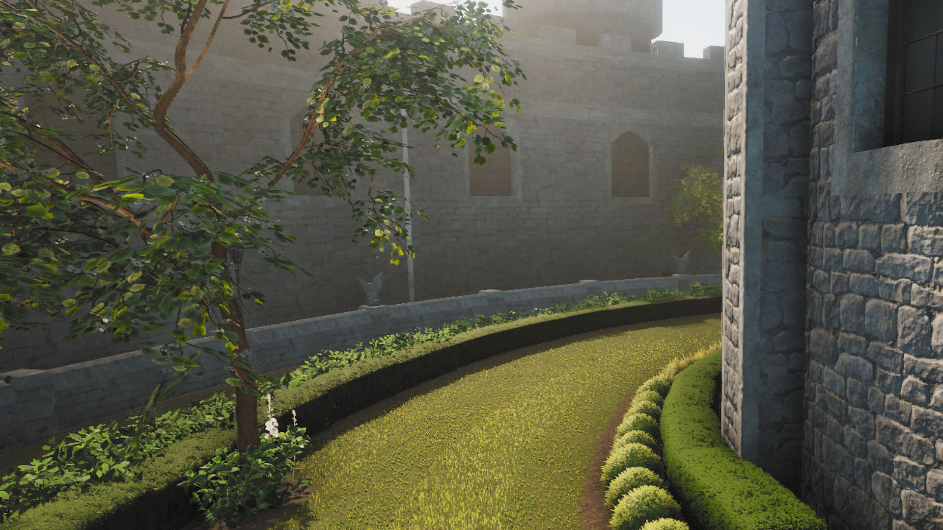 A screenshot from Lawn Mowing Simulator, a lawn stretching around the outside of a castle, with hedgerows either side.