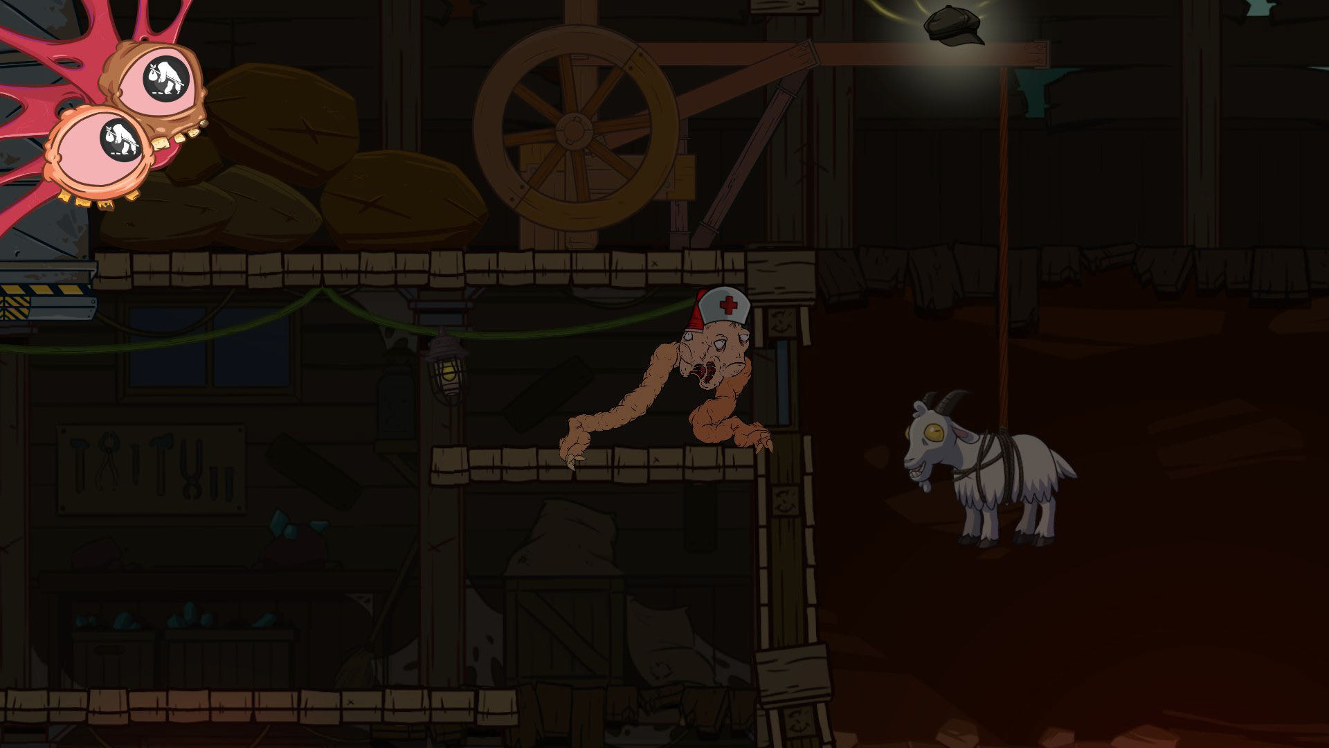 A screenshot from Struggling, showing your blob approaching a goat, which is hanging from a pulley system.