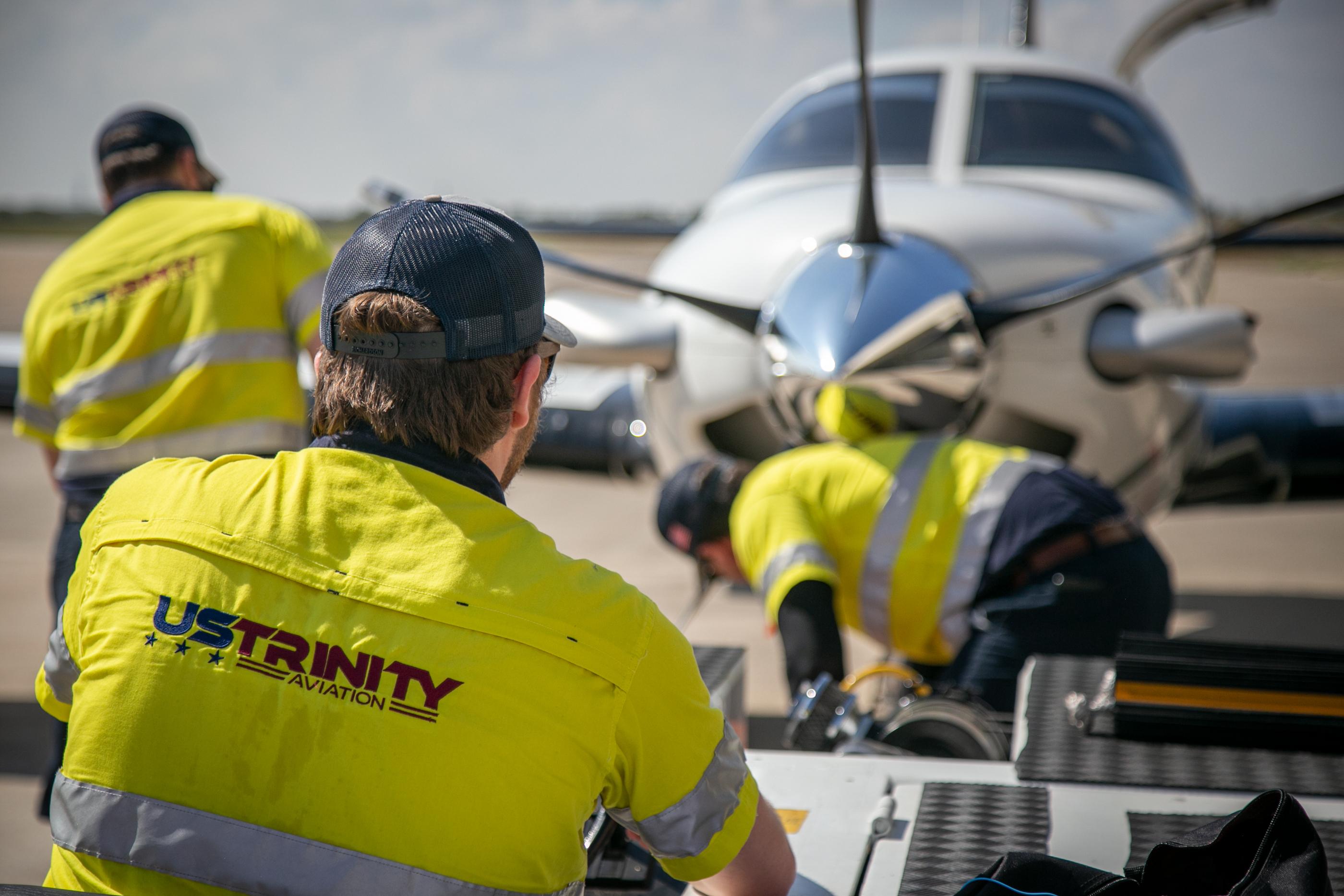 Linemen handling aircraft