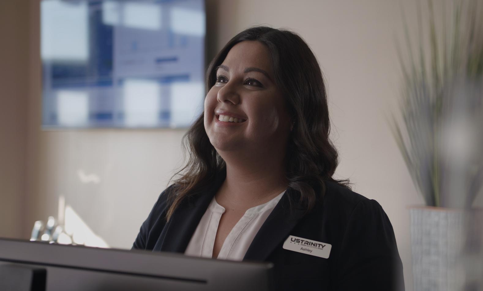 Representative smiling at service desk