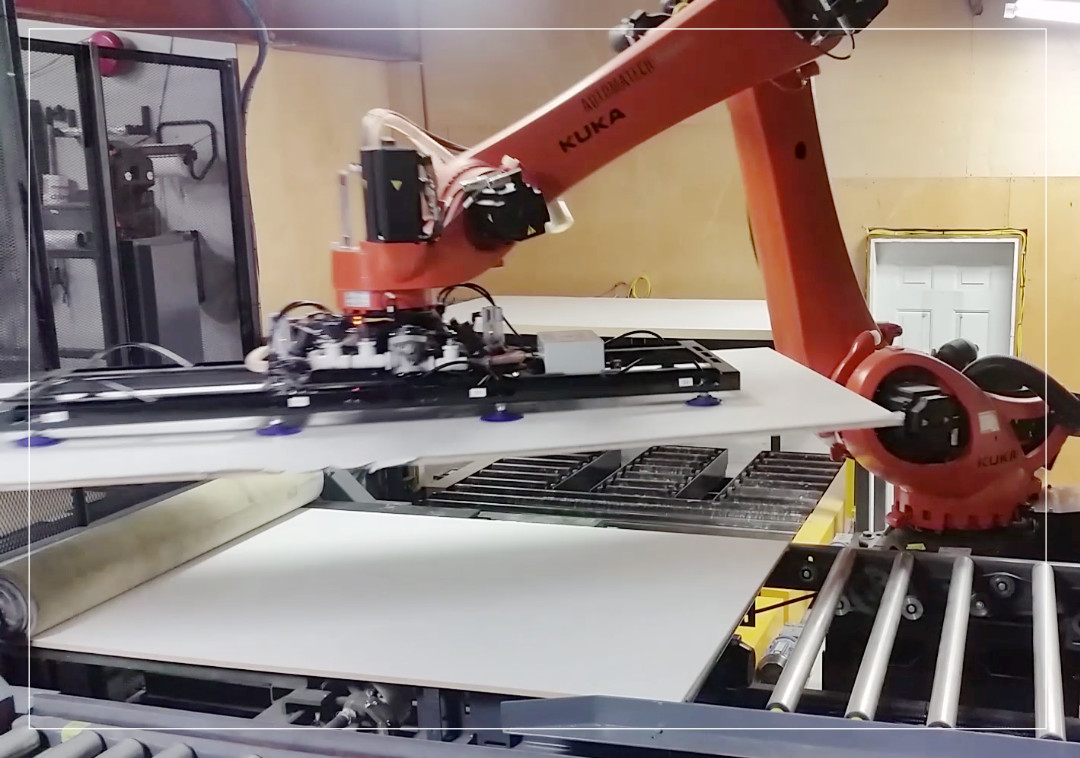 Robotic cell to palletize laminated panels