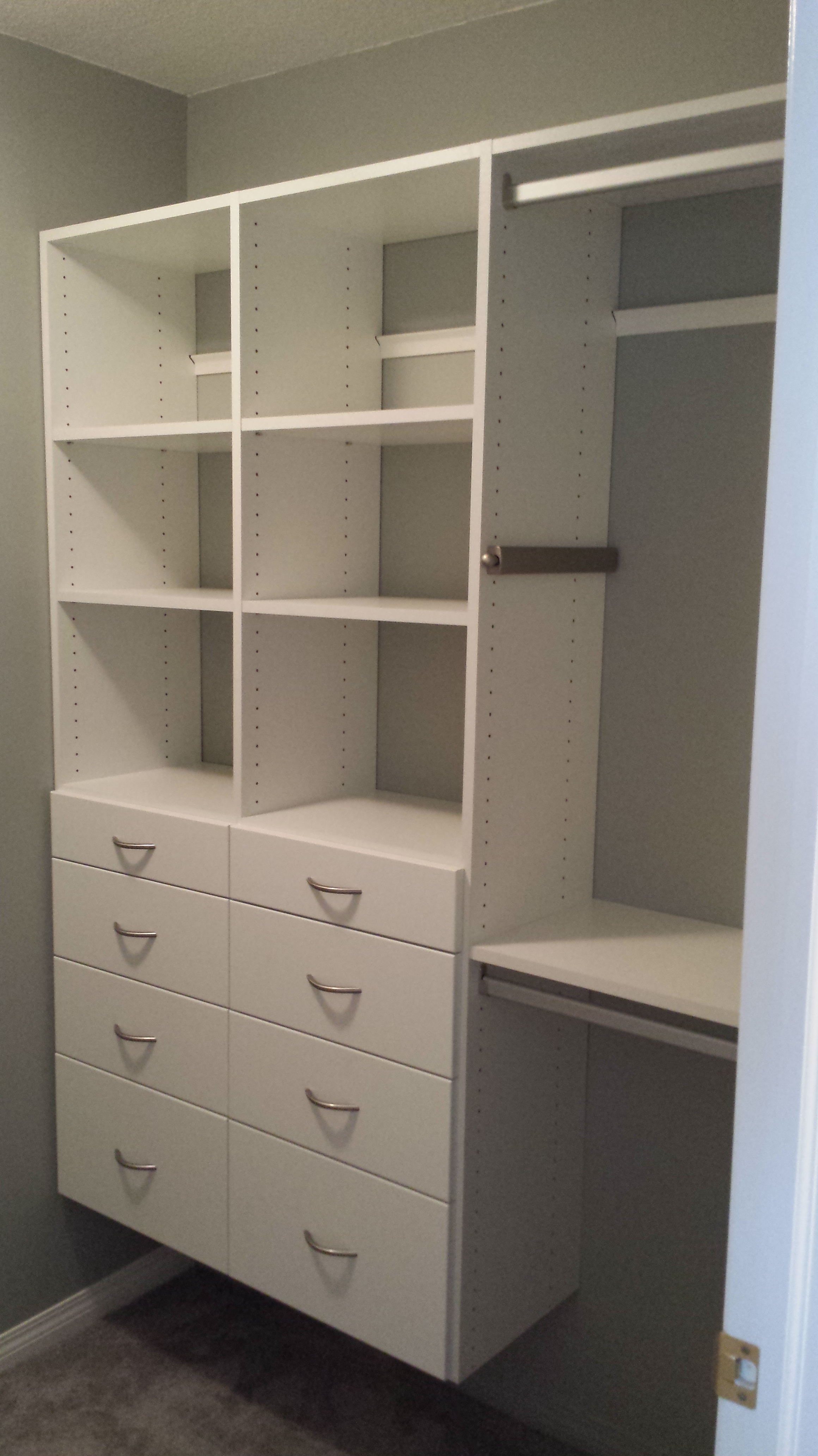 Custom built closet with white wardrobe.