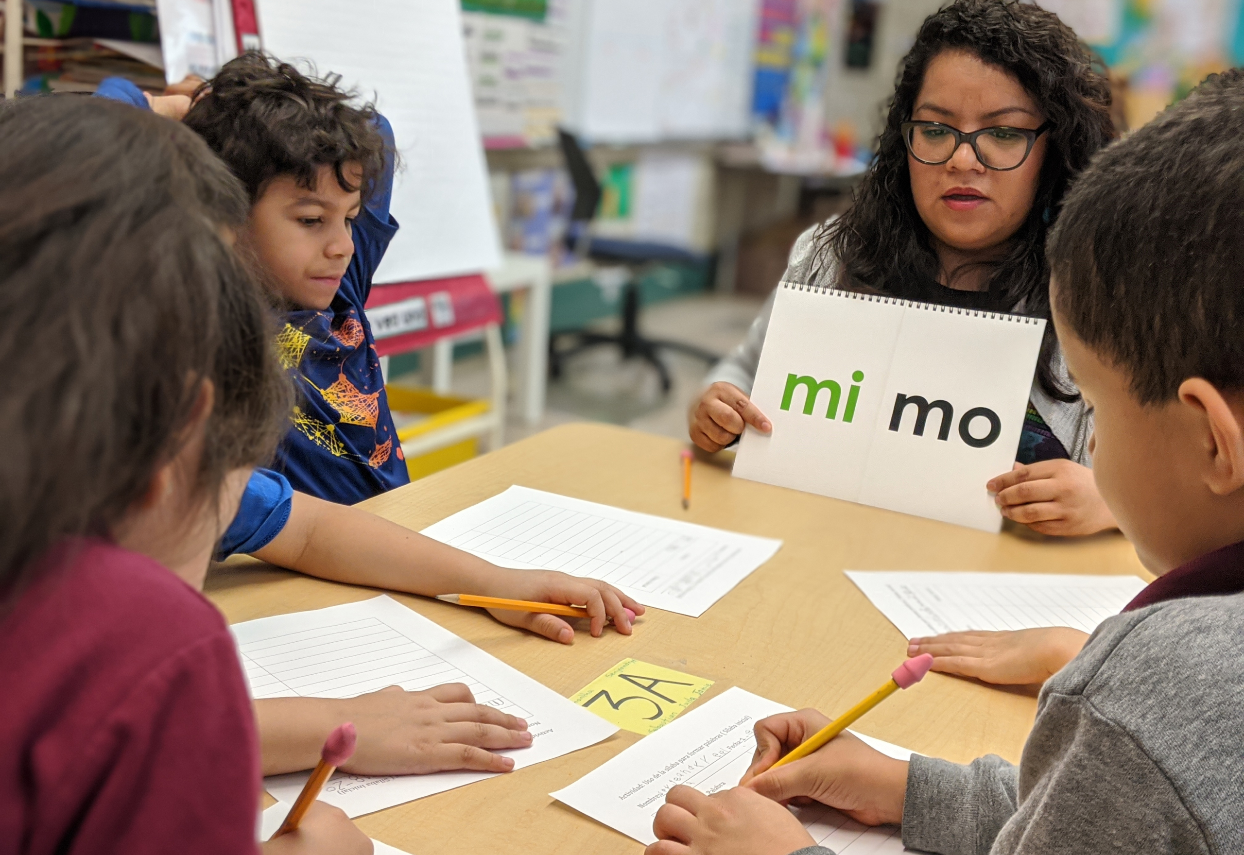 Teacher teaching Spanish to a group of students