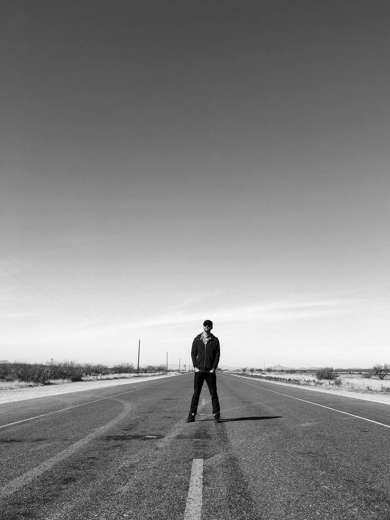 Max Miner standing in an empty highway