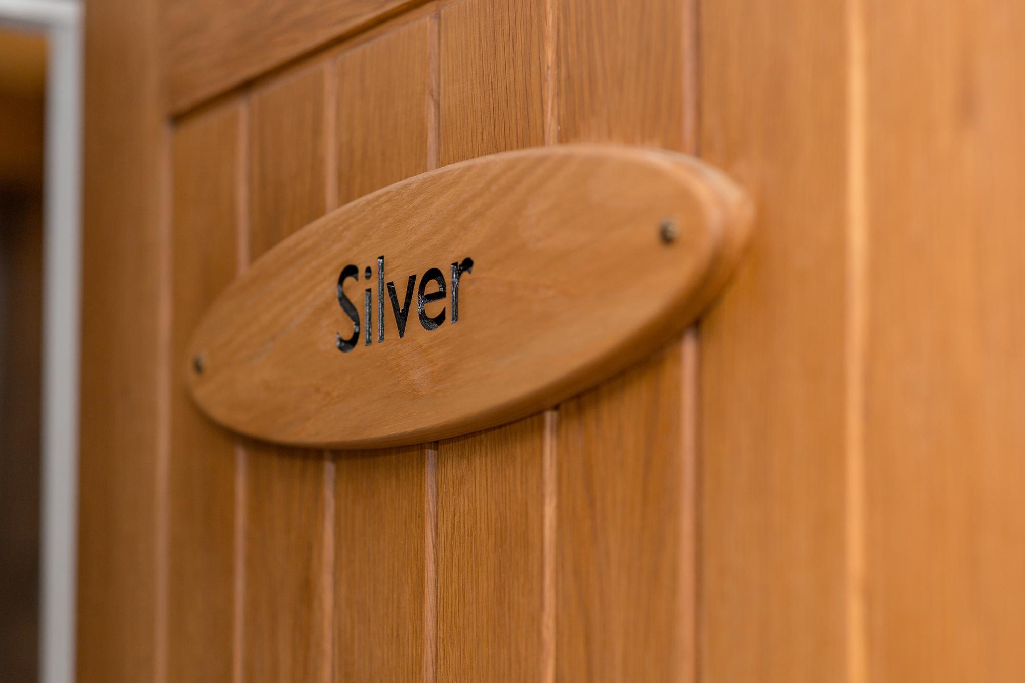 Silver room name on door