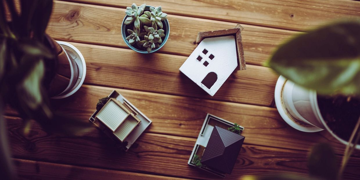 small decorative model homes on a desk
