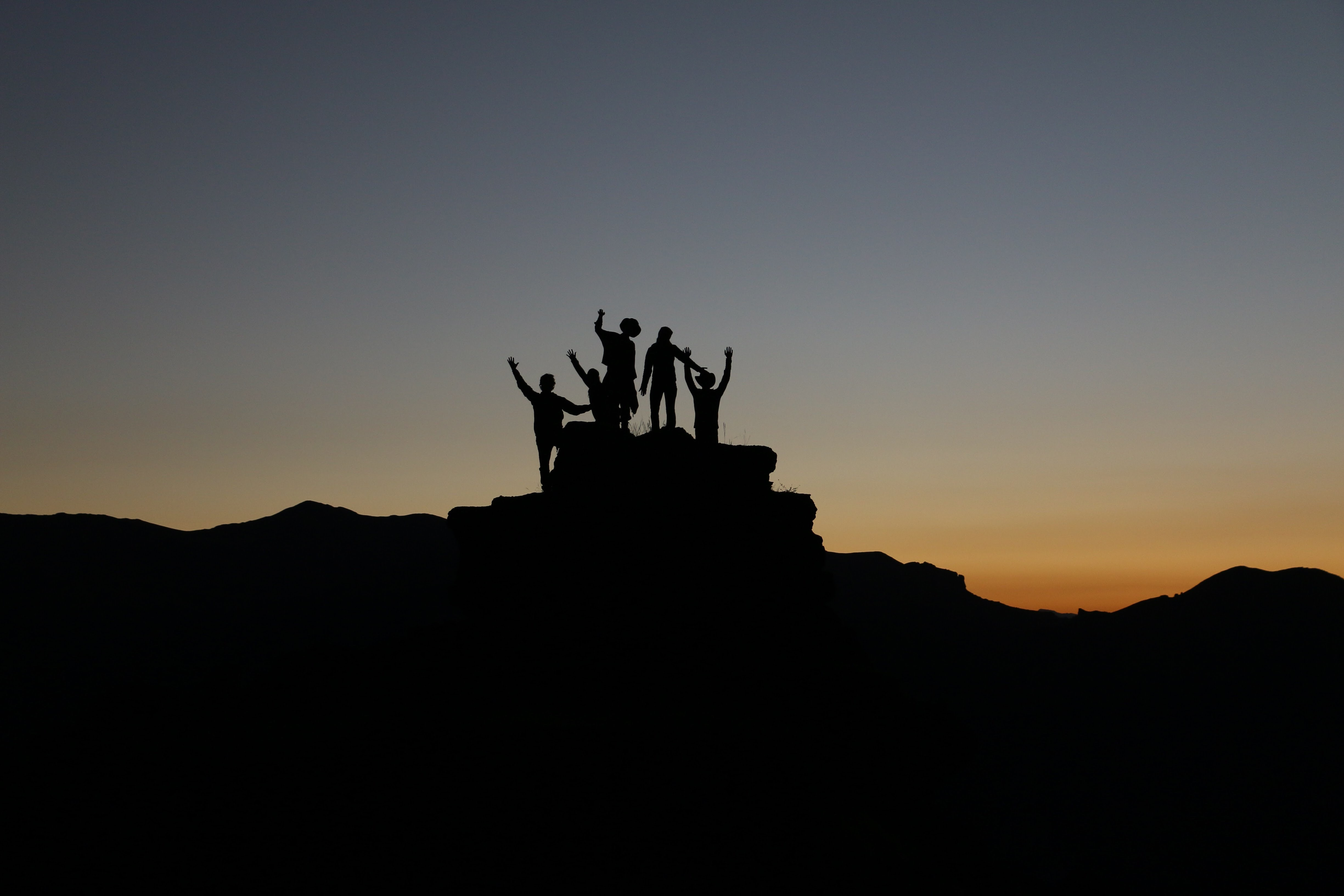 a team celebrating on top of a mountain
