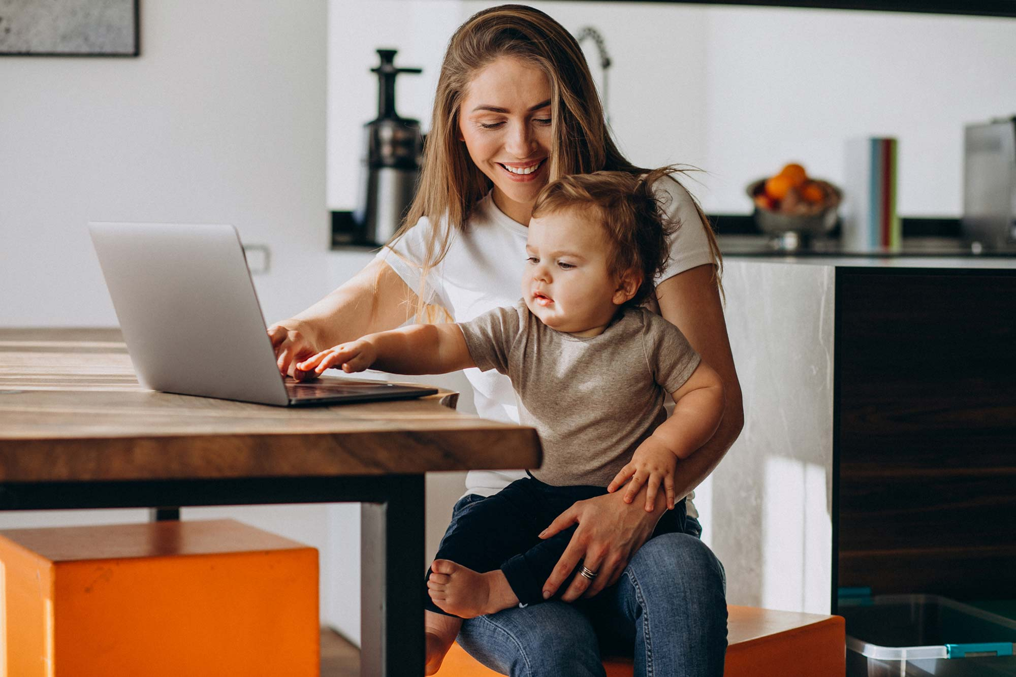Photo of a mother and the baby on the laptop computer