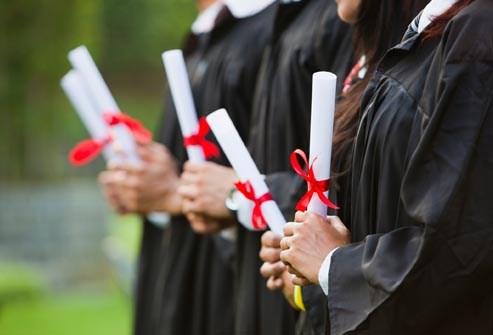 graduates holding degrees
