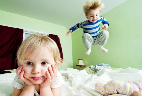 siblings in bedroom