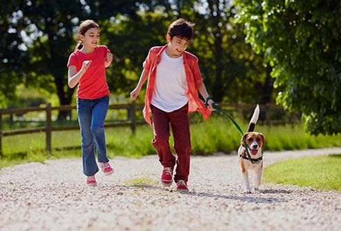 kids walking dog