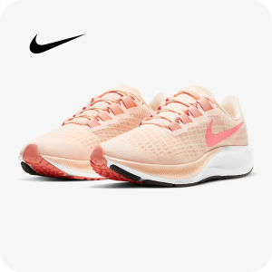 A pair of Nike running shoes in light coral and white, with a black sole.