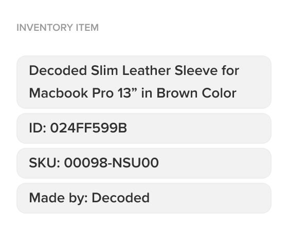 A picture of the auto-generated custom labels detailing the inventory number, SKU and product title from an image of a laptop sleeve.