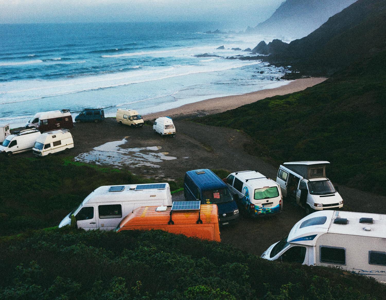 Vans with solar panels camping at beach