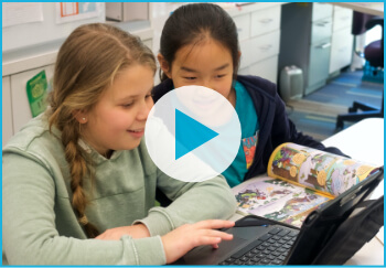 Two young girls looking at Beast Academy books