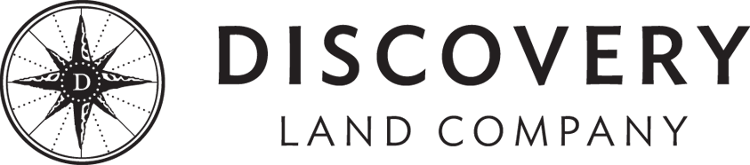 Discovery land logo