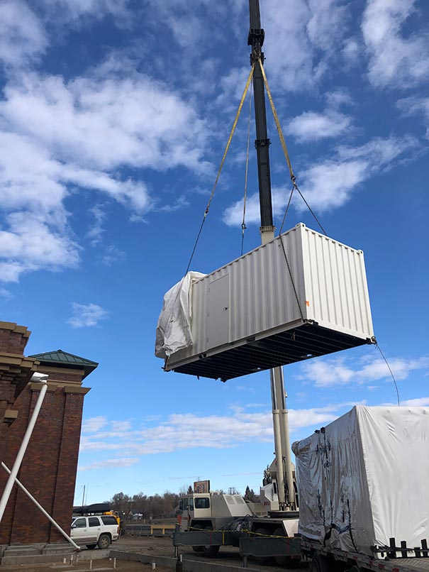 crane lifting shipping container kitchen