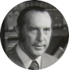 A black and white portrait of Derek Prince.