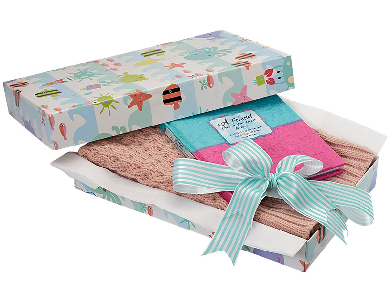unique gift box displayed with present and ribbon