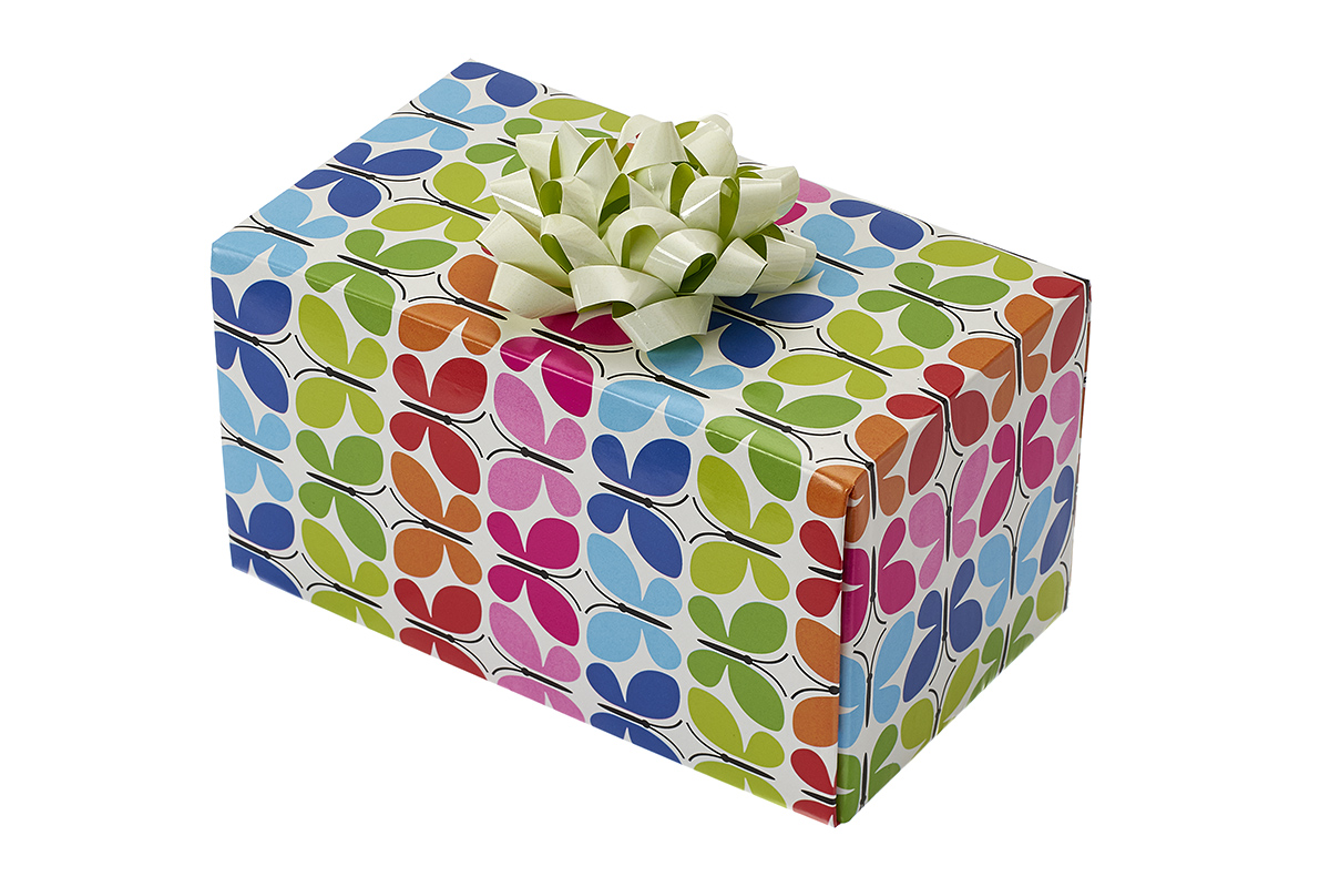 single wine box packaged with gift wrap and a bow