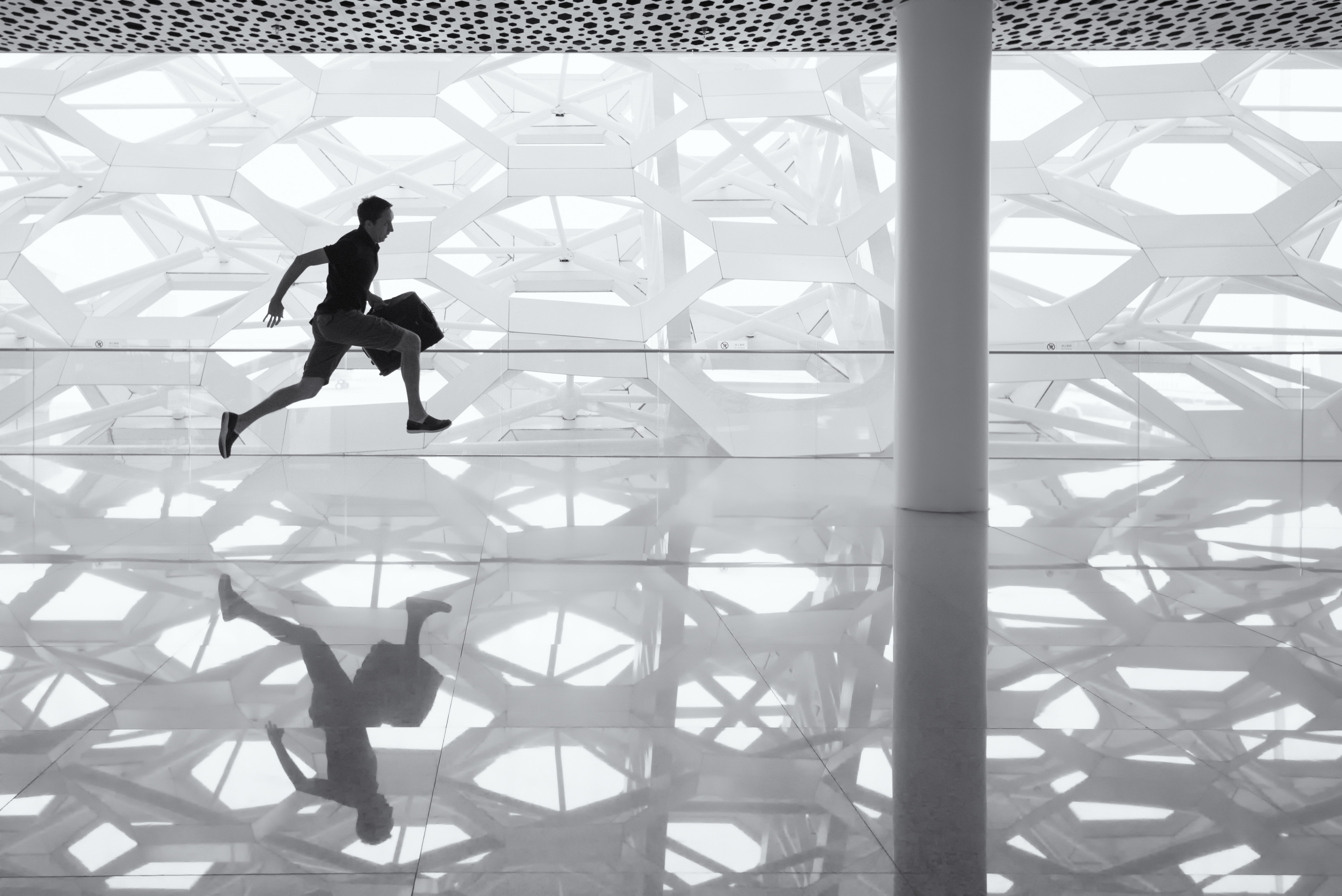 Man running through an airport — photo by Andy Beales on Unsplash