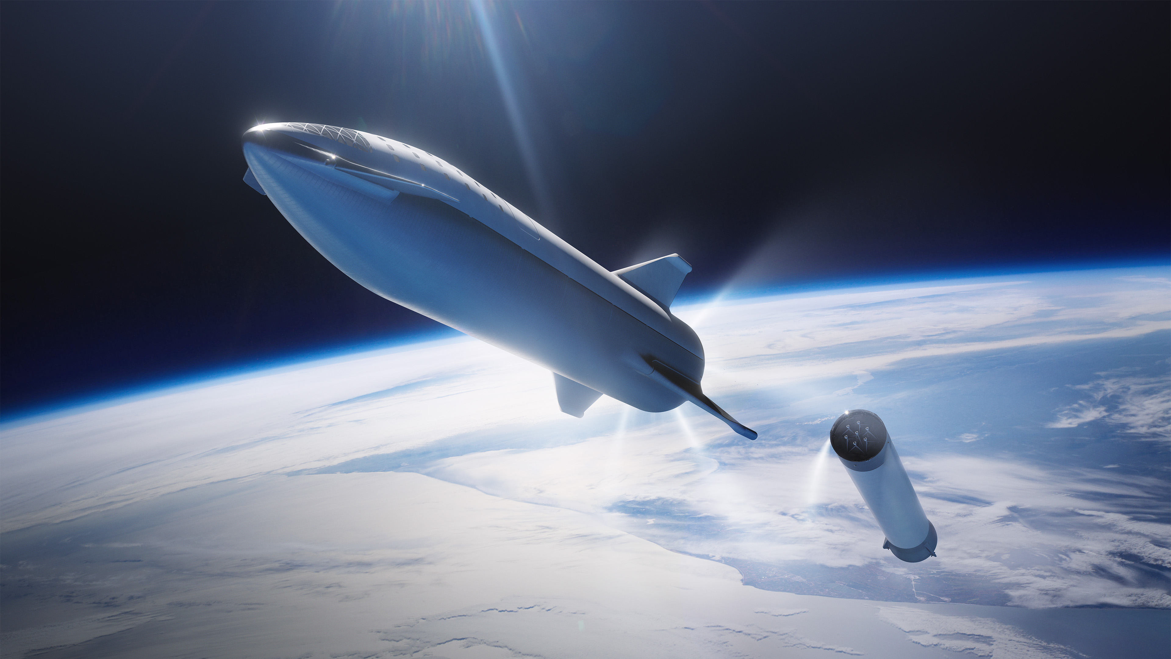 Photo of a rocketship dropping it's booster in low earth orbit