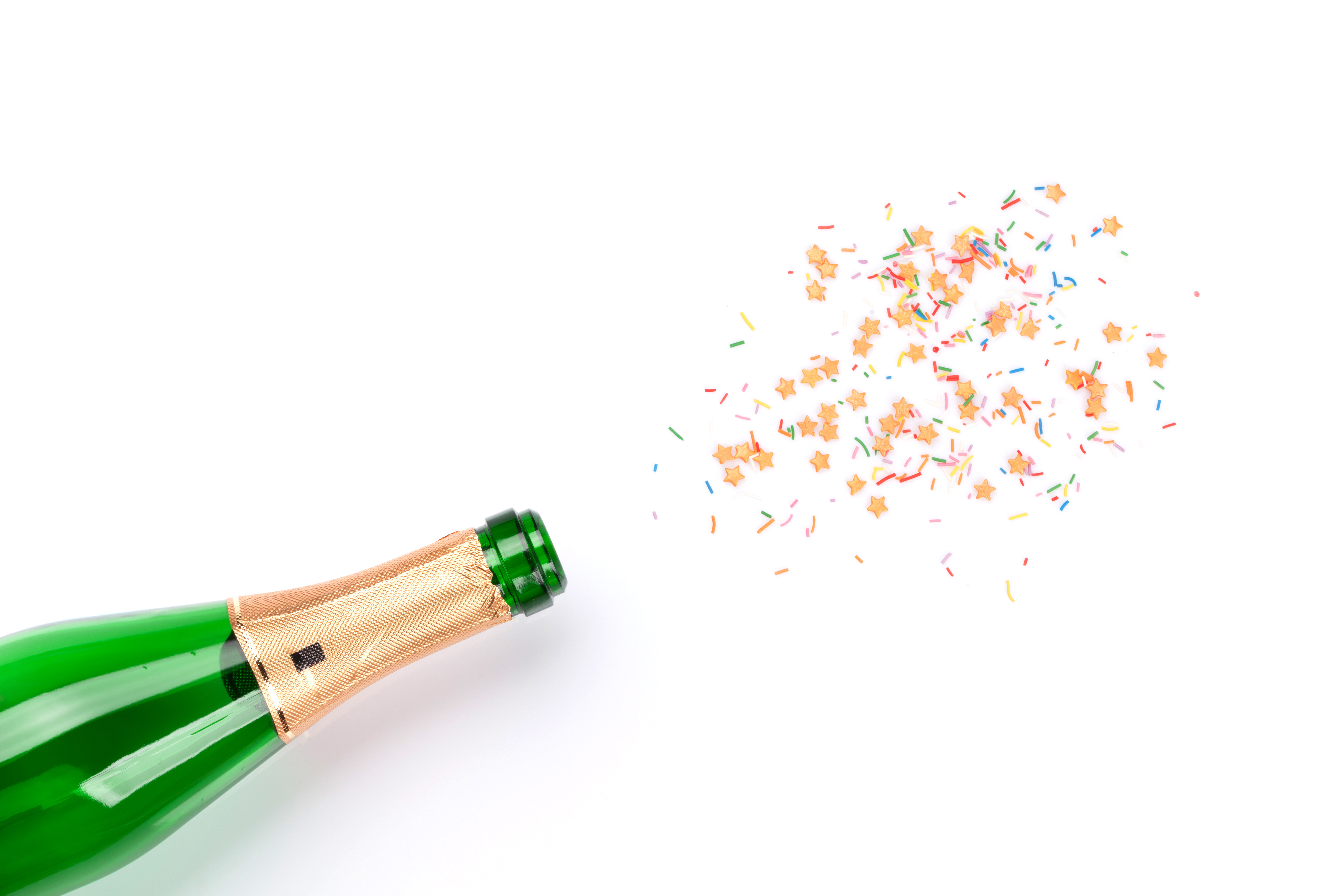 Photo of champagne bottle with confetti