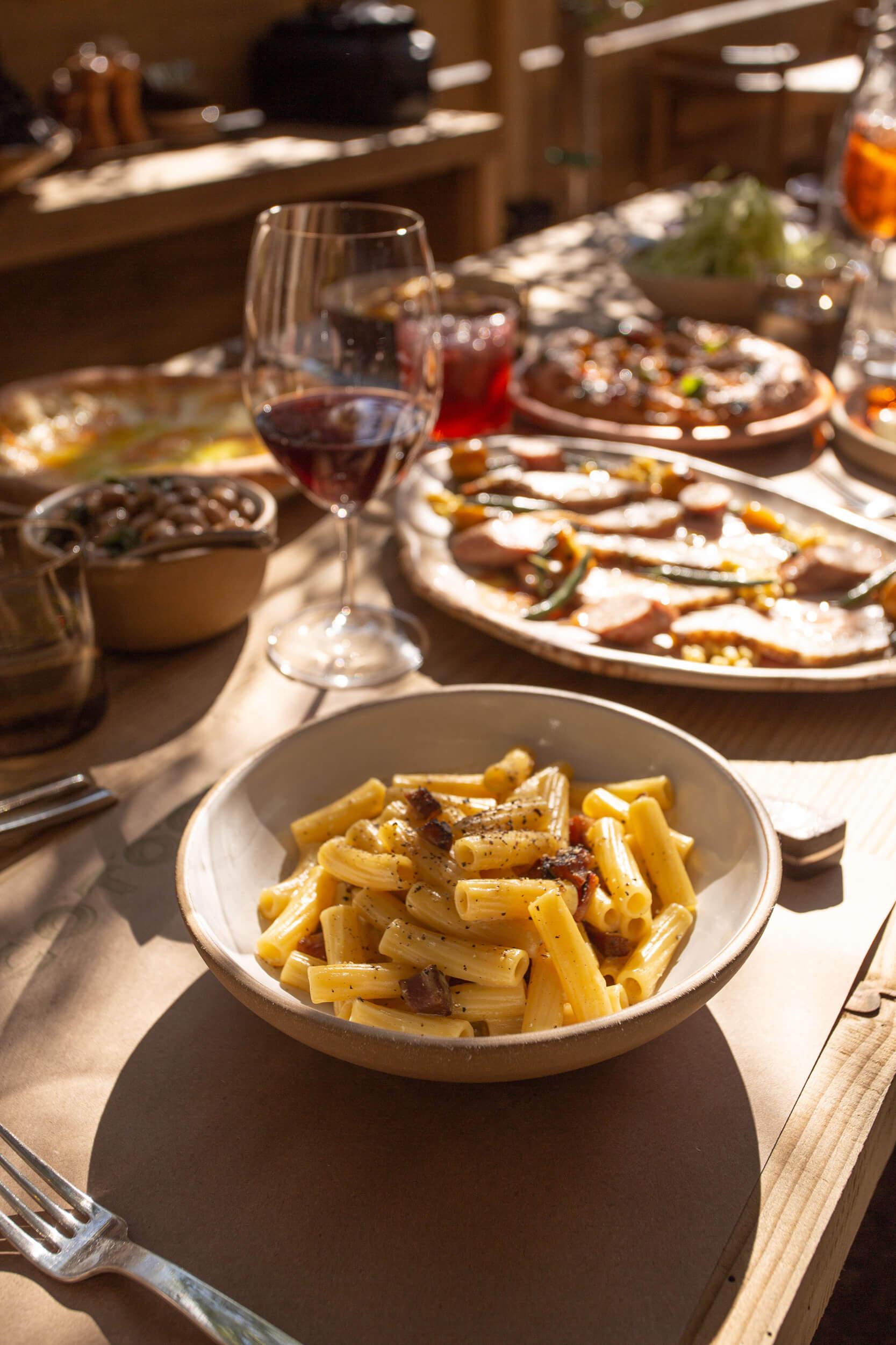 Plates of pasta, caviar, cake, meet, and sauces.
