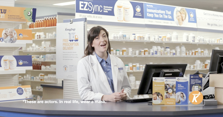A woman pharmacist wearing a lab coat
