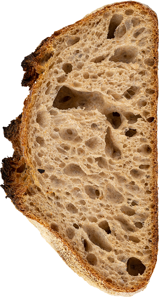Side vie of cut sourdough loaf by Bread Pantry