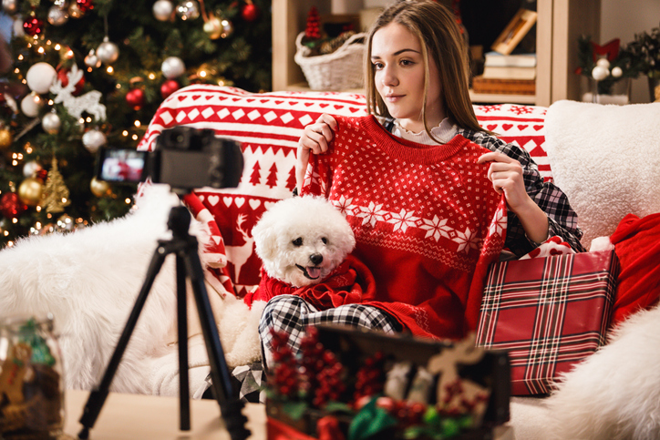 holiday influencer filming a video haul