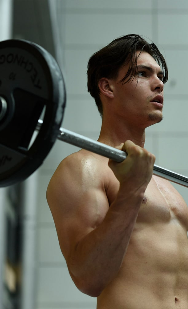 Clubsportive member holding a barbell